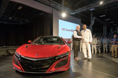 2017 Acura NSX VIN 001 reveal_high res 5-24-16 / From left, Rick Hendrick, owner of Hendrick Motorsports and Hendrick Automotive Group, takes delivery of 2017 Acura NSX, VIN 001, from Acura NSX Engineering Large Project Leader Clement D'Souza. (PRNewsFoto/Acura)