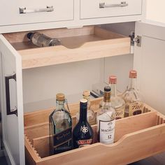 Cocktails anyone? Our bespoke liquor bottle drawers make it easy to keep all those bottles at the ready. ... #Kitchen#kitchenremodel#kitchendesign#beforeandafterhome#kitchens#kitchenstyle#instakitchen#kitchencabinets#homedecor#designideas#homedesign#kitchendecor#interiordesigner#interiordesign#interiorinspo#newkitchen#kitchengoals.