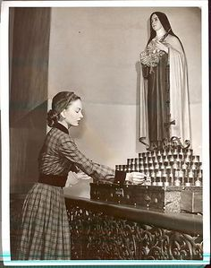 Candle and Statue of St. Theresa are both Sacramentals of the Catholic Church.