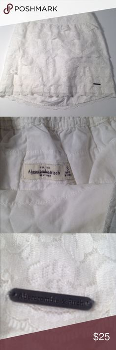 Abercrombie & Fitch White Lace Skirt Abercrombie & Fitch White Lace Skirt. Size S and composition is 100% nylon for the shell and 100% cotton for the lining. Length top to bottom is 14 inches and is in excellent condition! Abercrombie & Fitch Skirts