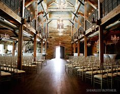 The Wedding Aisle includes 72 feet of custom 3 foot tall gas lanterns and luxurious glass and crystal chandeliers. #wedding #venue #oklahoma