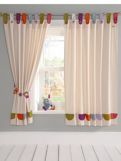 Beautiful designed mid length curtains with multi-coloured tab tops in assorted printed fabrics. Size: 132 x 160 cm each curtain.Please note tie backs not included.