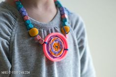 Turn your old Play Doh lids in this wearable weaving with make-it-your-own.com (Creative activities for kids!)