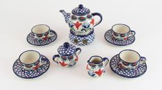 """This adorable tea set includes the tea pot, warmer, sugar bowl, creamer, and 4 cups & saucers (12 pieces total). The cups are 1"""" tall, and the tea pot is 3"""" tall."""