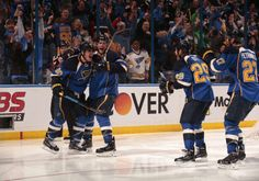 ST. LOUIS, MO - APRIL 17: Alexander Steen #20 of the St. Louis Blues celebrates with teammates after scoring the game-winning goal in the third overtime period against the Chicago Blackhawks in Game One of the First Round of the 2014 Stanley Cup Playoffs at the Scottrade Center on April 17, 2014 in St. Louis, Missouri.