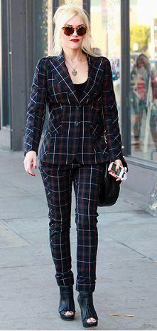 Who made Gwen Stefani's fringe black boots, plaid pants suit? Jacket, shoes, and pants – L.A.M.B.