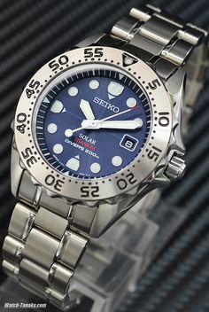 Seiko SBDN003 Titanium Diver (Solar), weighs 85g, 12mm thick, 40mm case. Possibly discontinued. See also the Citizen PMX56-2812.