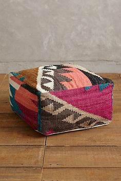 Great colors in this dhurrie inspired pouf.