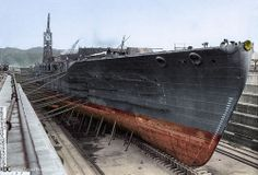 Unusual colourised view of  Japanese Nagato class battleship undergoing major reconstruction.