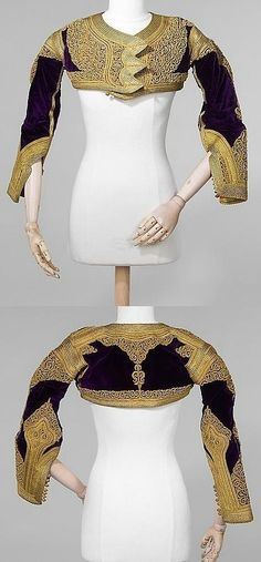 Woman's jacket, part of a ceremonial costume.  Albanian, late-Ottoman era, 1875-1900.  Gold (metal thread) embroidery on silk velvet; cotton lining.  Length: 25½ cm.  (Met Museum, N.Y.).