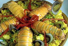 Cuban-style Paella: Paella Cubana from FoodNetwork..  Bijol is used to give the rice its yellow color.  You can also use azafran spice.