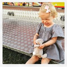 Laughing girl with LittlePetit hair bow