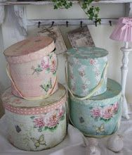 vintage wallpaper covered hat boxes