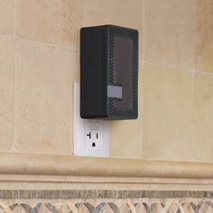 The Wall Outlet Bluetooth Speaker - Hammacher Schlemmer