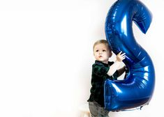 A two year old boys birthday party ideas with balloons and finger paint and trains everything a little boy is made of... #birthdayphotoshoot 2 year old boy #poseideas