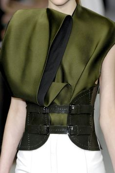 Gorgeous olive green silk jacket. No idea who it's by though...