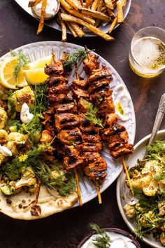 Lebanese Chicken with Charred Lemon Cauliflower Grilled Lebanese (or roasted) style chicken, served with charred lemony cauliflower and herb salad, cucumbers, and the most deliciously addicting garlicky yogurt sauce. Easy Summer Meals, Summer Recipes, Shish Tawook, Lebanese Chicken, Grilled Chicken Skewers, Cuisine Diverse, Herb Salad, Cooking Recipes, Healthy Recipes