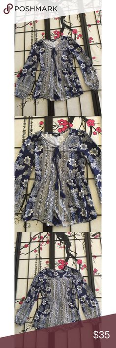 Lulu's Long Sleeve Floral Romper Measurements - Bust 20in (40) Length 27in This Romper has a bit of wash wear but otherwise in beautiful condition. Laces up in the front! Lulu's Pants Jumpsuits & Rompers