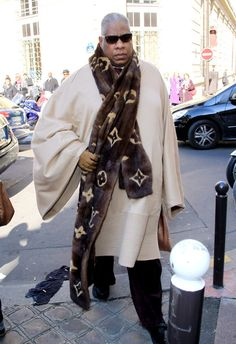 Andre Leon Talley, current contributing editor to American Vogue, overwhelmed by his enthusiasm for Louis #Vuitton in a 6 foot long, logo emblazoned mink scarf.