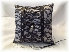 White Satin with Black Lace Lace-Up Halloween Gothic Wedding Ring Pillow. $40.00, via Etsy.