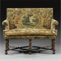 A NORTHERN ITALIAN TAPESTRY UPHOLSTORED AND TURNED SOFA, 17TH-18TH CENTURY;