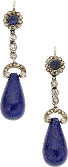 Edwardian Lapis Lazuli, Diamond, Platinum, Gold Earrings. The earrings feature teardrop and round-shaped lapis lazuli cabochons, enhanced by European and single-cut diamonds, set in platinum, completed by 14k gold lever backs.
