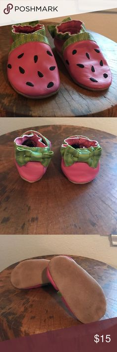 Robeez Watermelon Slip on Mocs Robeez slip on moccasins. Tops are pink with black sewn seeds. Green trim and green bow on the back. Sized for a 6-12 month old. Robeez Shoes Baby & Walker