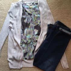 Loft Flowered Peplum Blouse Worn once.  Dark grey background with light grey, purple, green and blue floral print.  Material is sheer but does not require cami underneath. LOFT Tops Blouses