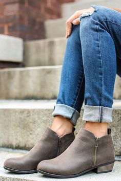 """When it's been a long day and you're ready to Kick Back with some friends, these Grey Ankle Boots will be perfect for the occasion! You'll be taking it easy in style! These suede ankle boots feature a round toe, a low heel, and a zipper on both the outside and instep.  • Heel measures 1"""" • Padded Insole • Non-Skid Sole • Vegan friendly, man made materials • Imported"""