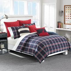 This one has red. The other plaid doesn't... Nautica® Clearbrook Comforter Set - BedBathandBeyond.com