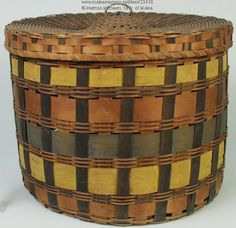 """Penobscot band basket, ca. 1860. This form of basket is referred to as a """"band"""" basket from the brightly colored splints used in the piece. Cadmium yellow, iron oxide red, Prussian blue and indigo were swabbed onto the exterior surface of the splints only. Such commercially produced pigments were costly and used sparingly. Band baskets were destined for home use to store hats, clothes or linen, or for use in travel as """"suitcases."""" Item # 23438 on Maine Memory Network"""