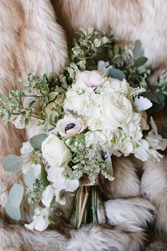 Elegant Winter Wedding Bouquet with Blush Anemones, Hydrangea, and Dusty Miller wrapped in Faux Fur | Natalie Franke Photography