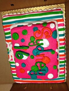 Neon orange, lime green, teal/ turquoise blue, hot pink, and white frosting with chocolate cake! <3