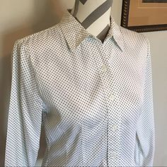 Apt. 9 button down shirt Super cute and soft button down! White with tiny navy polka dots. 97% cotton 3% polyester. 22 1/2 in long. Bust 16 1/2 in across. Sleeves 22 in long. Size Medium. Apt. 9 Tops Button Down Shirts