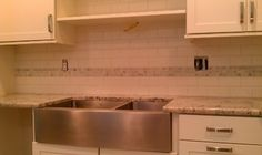 subway tile and grey/taupe marble accent