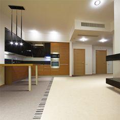 Porcel-Thin TOSCA cream and mocha concrete effect porcelain floor tiles in a large modern kitchen.