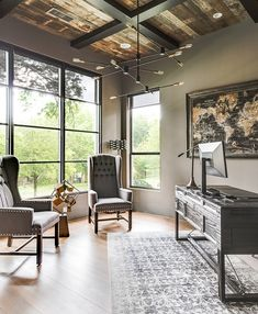 Gauntlet Gray by Sherwin-Williams This masculine home office features black steel windows and barn wood ceiling with boxed beams. Wall paint color is Gauntlet Gray by Sherwin-Williams Gauntlet Gray by Sherwin-Williams Gauntlet Gray by Sherwin-Williams Office Interior Design, Home Office Decor, Office Interiors, Office Ideas, Office Designs, Home Office Paint Ideas, Masculine Home Offices, Masculine Office Decor, Urban Farmhouse Designs