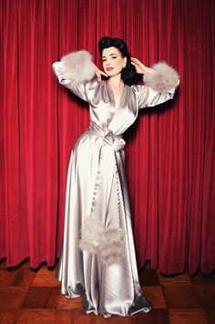 """Introducing the first collector's piece for the Dita Von Teese Collection by Catherine D'Lish! The """"Holiday Gown"""". This luxurious dressing gown is..."""