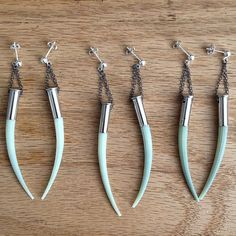 Need these!! amazing Dentalium tusk bullet earrings in by cravejewelrydesign, $35.00