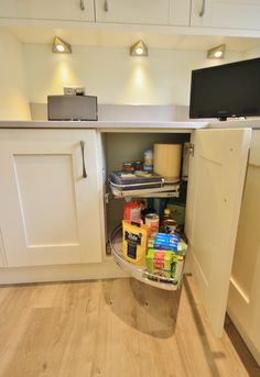 Clever storage options, pull out Lemans shelves which cover the space at the back of the cupboard. Each shelf can hold