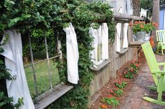 Old windows in a fence. Think we could do this to back fence to show the beauty of the wet lands behind us. Backyard Fences, Backyard Landscaping, Landscaping Ideas, Backyard Ideas, Brick Planter, Fresco, Old Windows, Antique Windows, Vintage Windows