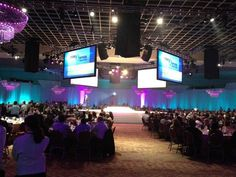 PSAV provided approximately 1600-feet of white drape and eight wide screens back to back for a 360-degree view. — at Rosen Shingle Creek.