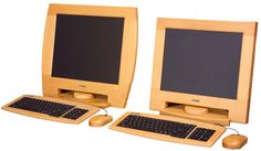 Wood encases monitors and keyboard