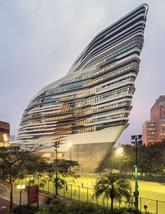 Jockey Club Innovation Tower at Hong Kong Polytechnic University rising 15 stories, the concrete, steel, and glass edifice is shaped like a ship's prow, encompassing classrooms, lecture halls, and other instructional spaces - Zaha Hadid Architects
