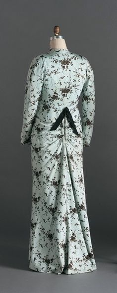 "Theatre Suit, Christobal Balenciaga (Spanish, 1895-1972): winter 1945 no. 118, silk faille, silk velvet and sequins, embroidery by Bataille. ""...made for... Miss Elizabeth Arden.   Arden was a driven entrepreneur in the newly developing beauty-products industry during the early twentieth century. Her products, salons, and resorts made her one of the richest women in the nation's history. By the time she wore this... suit in 1945, Arden had become a brilliant and famous hostess and…"
