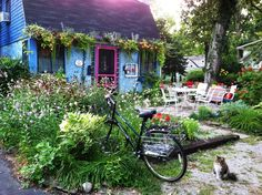 """#402 is the address and """"Small Change Cottage"""" is the name of this wonderful little cottage in Lakeside Ohio!  Our favorite little space with an abundance of curb appeal!  Photo by ParadeOfGardens.com."""