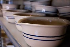 Marshall, Texas pottery - you can still watch the potters make the vessels on the wheel.  The blue stripes are traditional for this pottery & lot of the potters sign their work on bottom, especially those with designs (many use bluebonnets, state flower).