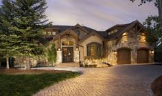 A stone exterior and wooden garage doors are two of my favorite things.