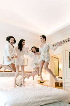 Bride and bridesmaids jumping on the bed shot! | Glamourous Bridal Prep Inspiration, Old Hollywood Style