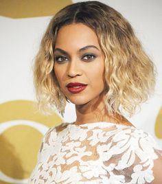 All hail Queen B! Her vampy red lip and smoky eye look from the 2014 Grammys will leave you speechless
